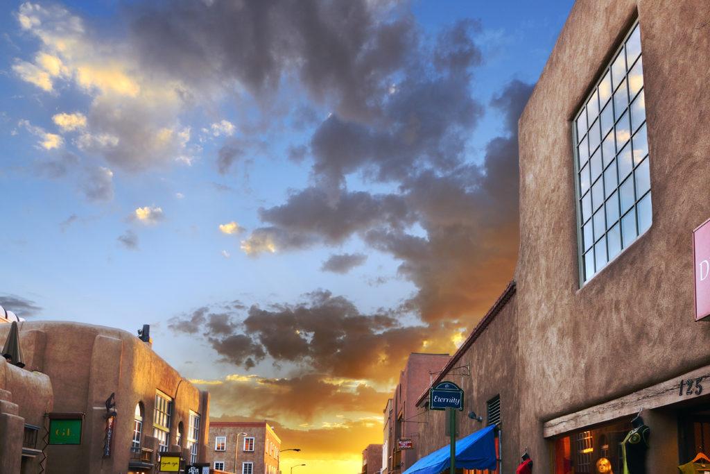 A busy Santa Fe shopping center at sunset